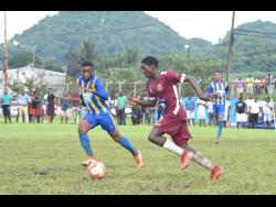 St Elizabeth Technical's (STETHS) Mushtaq Christopher  (left) and Maggotty High's  Rohan Palmer battle for the ball during an ISSA/WATA daCosta Cup Group E match at Appleton Sports Complex earlier this month. STETHS won 1-0.