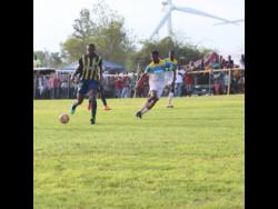 St Elizabeth Technical High School captain Antonio Biggs (right) tracks Munro College's Torain Young during their ISSA/WATA daCosta Cup game at Munro on September 14, 2019.