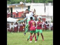 Frome Technical High's Clifton Suban clears the ball from his defenders at Green Island during their ISSA/WATA daCosta Cup match at the Green Island playing field last year.