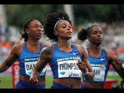 Elaine Thompson of Jamaica (front) competes on her way to win the women's 100m the IAAF Diamond League athletics meeting at Charlety Stadium in Paris,  August 24, 2019.