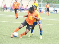 Kemar Flemmings (left) of Tivoli Gardens FC  shielding the ball from Harbour View's Odorland Harding during a Jamaica Premier League match at the UWI/Captain Horace Burrell Centre of Excellence last Saturday.  Flemmings scored the opening goal in Tivoli's 3-1 win.