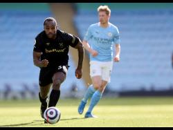 West Ham's Michail Antonio (left) in action against Manchester City in the English Premier League on Saturday, February 27, 2021.