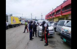 The police patrolling  sections of downtown Montego Bay, St James, on Wednesday.
