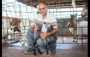 Trevor Bernard with some of the livestock on his farm.