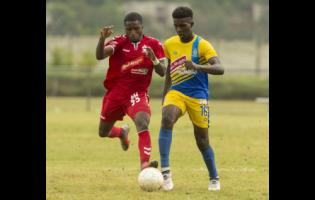 FILE Harbour View's Jabari Howell (right) comes under pressure from UWI FC's Jerondy Henry during a National Premier League match at the UWI Mona Bowl on January 9, 2019.
