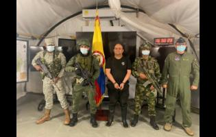 One of Colombia's most wanted drug traffickers, Dairo Antonio Usuga is presented to the media at a military base in Necocli, Colombia, on Saturday, following his capture.