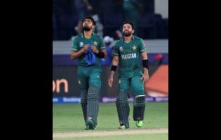 Pakistan's cricket captain Babar Azam (left) and Mohammad Rizwan celebrate after their team won the Twenty20 World Cup match between India and Pakistan in Dubai yesterday.