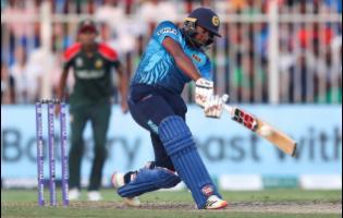 Sri Lanka's Bhanuka Rajapaksa hits a six during the Twenty20 World Cup match between Sri Lanka and Bangladesh in Sharjah yesterday.