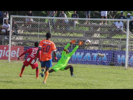 Lennon High goalkeeper Jovaun Grant (right) makes a point-blank save to deny B.B. Coke's Kaymani Case (left) during their ISSA/WATA daCosta Cup second-round first-leg game at the Juici Patties Park on October 16, 2019.
