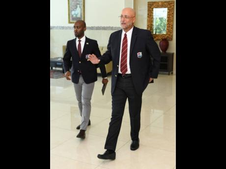 Cricket West Indies vice-president Dr Kishore Shallow (left) arrives at last year's annual general meeting with president Ricky Skerritt at The Jamaica Pegasus hotel.