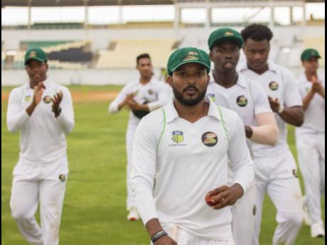 Man of the match Veerasammy Permaul is applauded off the field by his teammates after picking up eight wickets against the Jamaica Scorpions on day three of their Cricket West Indies Regional Four-Day Championship match at the Trelawny Stadium on Sunday, December 1, 2019.