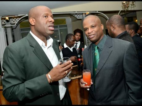 Nehemiah Perry (left) chats with Orville Brown at the Calabar Old Boys Annual Reunion Dinner at the Mona Visitors' Lodge on Saturday, October 5, 2013.