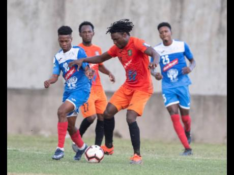 Action from the Red Stripe Premier League between defending champions Portmore United and Tivoli Garden at the Spanish Town Prison Oval on Sunday, March 1.