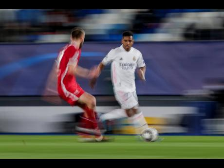 Real Madrid's Rodrygo Silva (right) runs with the ball during the Champions League quarter-final first-leg match between Real Madrid and Liverpool at the Alfredo di Stefano stadium in Madrid, Spain, yesterday.