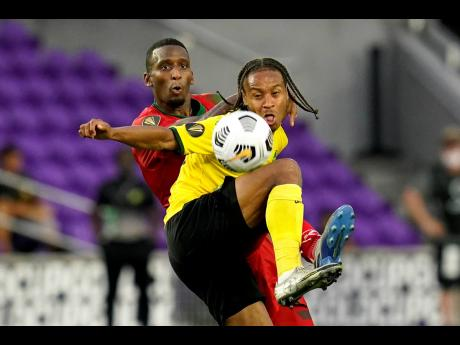 Reggae Boyz  forward Bobby Reid (front) should return to the team for the clash against the United States.