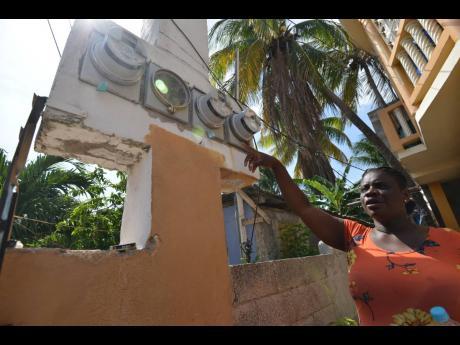 Lorraine Lambert points to her meters.