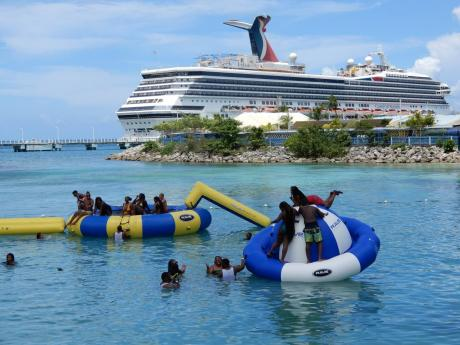 Tourists enjoy themselves by Island Village, close to the Ocho Rios Pier in St Ann on Monday. The Carnival Sunrise cruise ship docked in the north coast town.